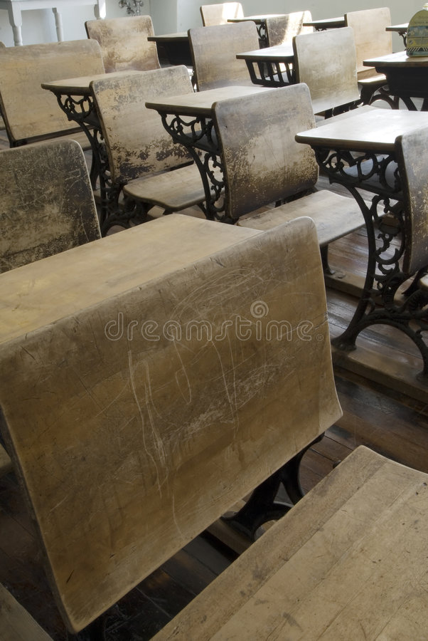 Vintage School Desks. This image shows a set of old school desks royalty free stock photography