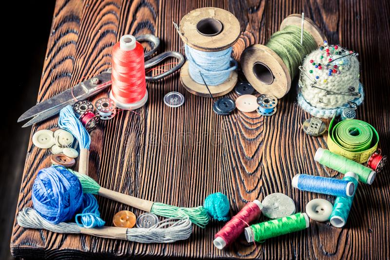 Vintage scissors, needle and threads as background royalty free stock photos
