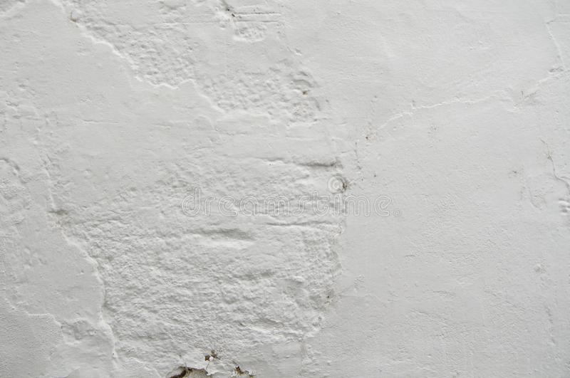 White Old Vintage Pain Peeling Wall Cracks Texture for background and design art work. Vintage Seamless Old Pain Peeling Wall Cracks Texture for background and royalty free stock images