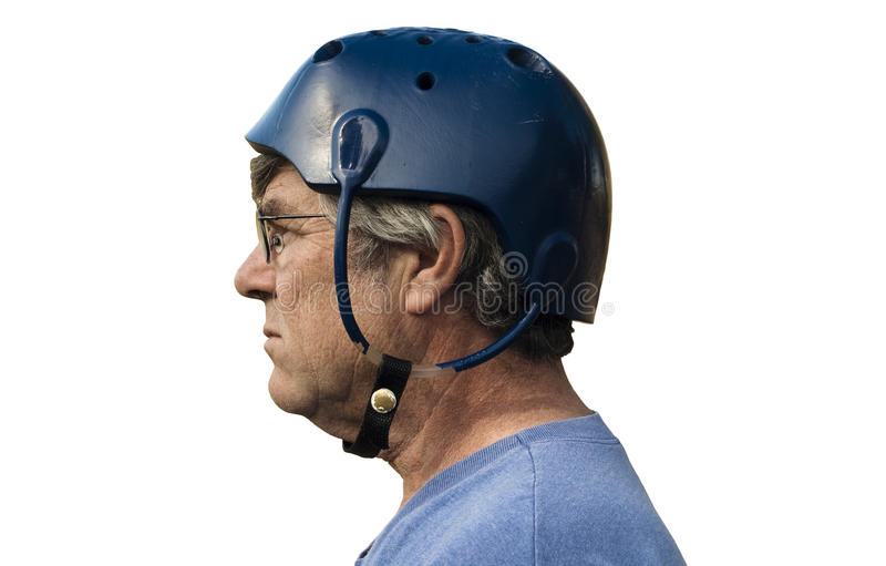Vintage seizure helmet. Man wearing a seizure helmet for protection with clipping path included royalty free stock photo
