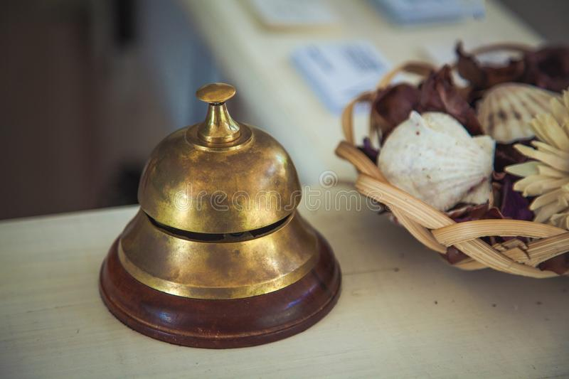 Vintage service bell on reception desk in hotel, close-up stock image