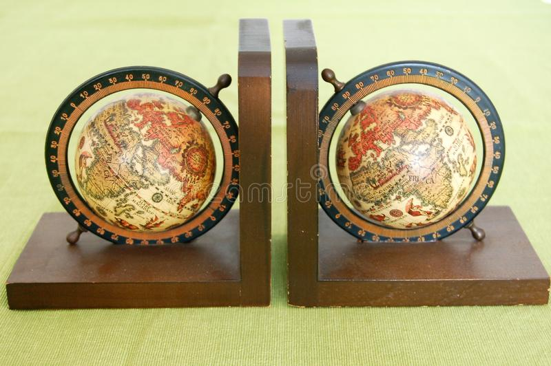 Vintage set of bookends with world globes royalty free stock images
