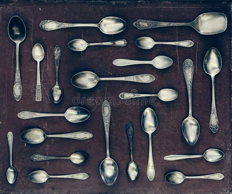 Vintage set of dessert spoons. On a dark background stock image
