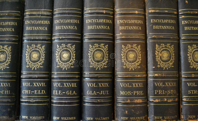 Encyclopaedias / Reference books. A vintage set of original leather bound encyclopaedias in a library stock photography