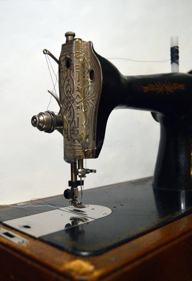 Vintage sewing machine close-up. Beautiful metal details. royalty free stock photos