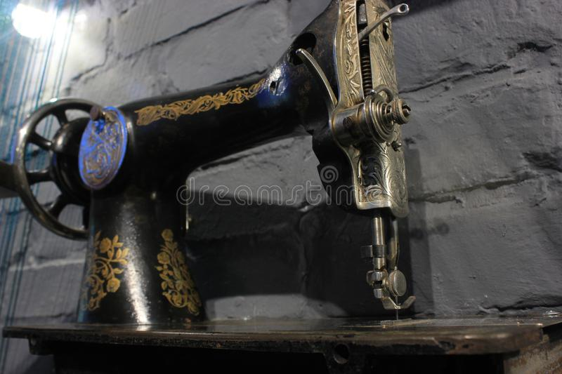 View from behind and downstair on the huge ketal Vintage sewing machine, for poster, text input, any design in royalty free stock images