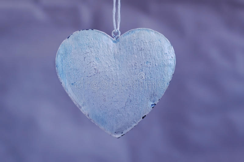 Vintage shabby hearts on the background of old paper shades of purple. Soft focus, background mode.  stock photo