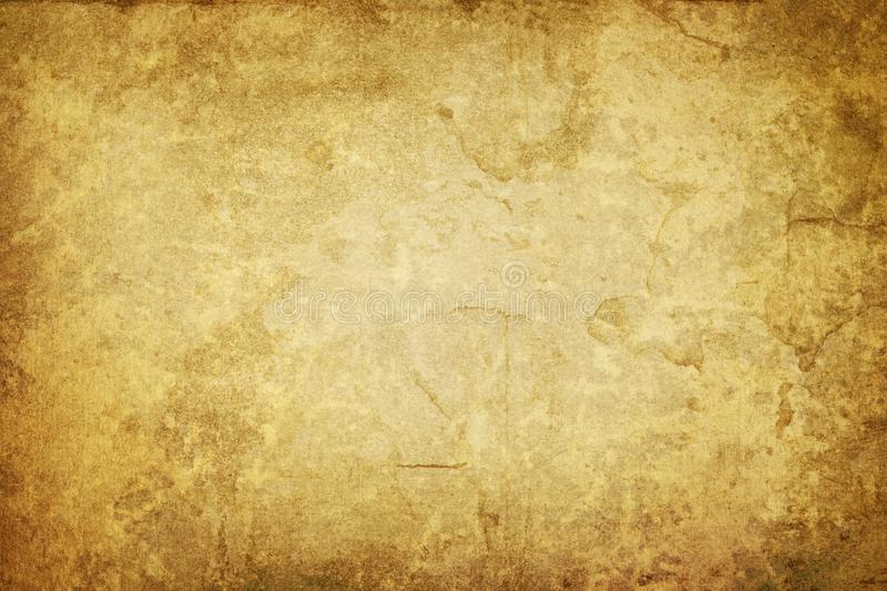 Vintage shabby paper background with dark borders. And stains stock photography