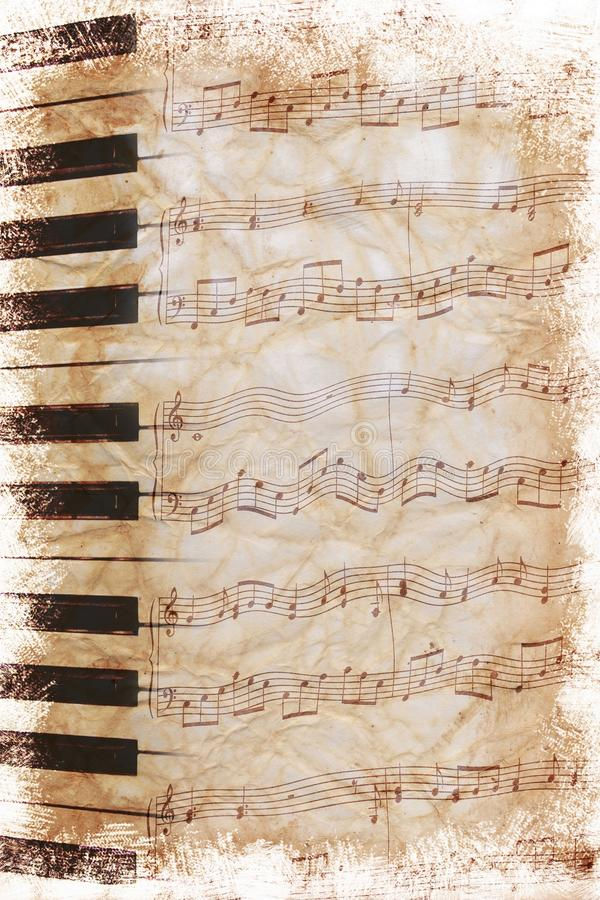 Vintage sheet music. Vintage sepia toned piece of sheet music with piano keyboard royalty free stock image