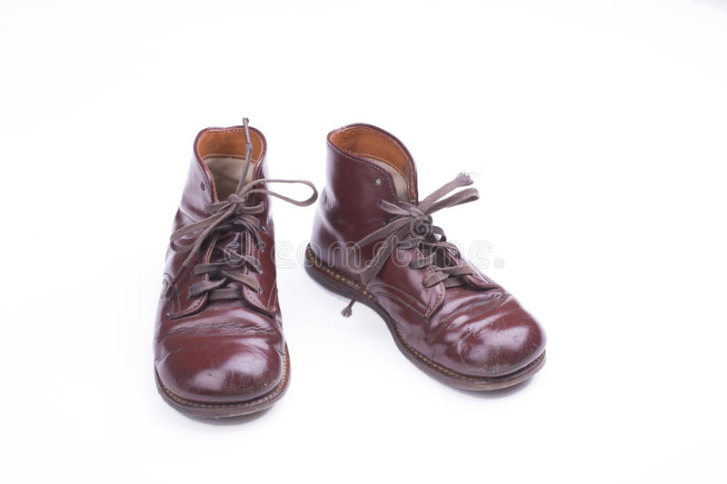 Vintage shoes. Pair of old childrens shoes on a white background royalty free stock image