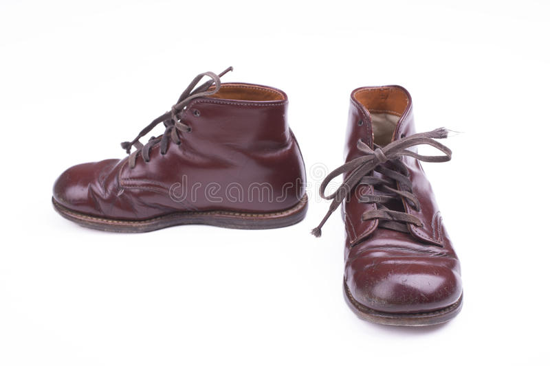 Vintage shoes. Pair of old childrens shoes on a white background stock photos