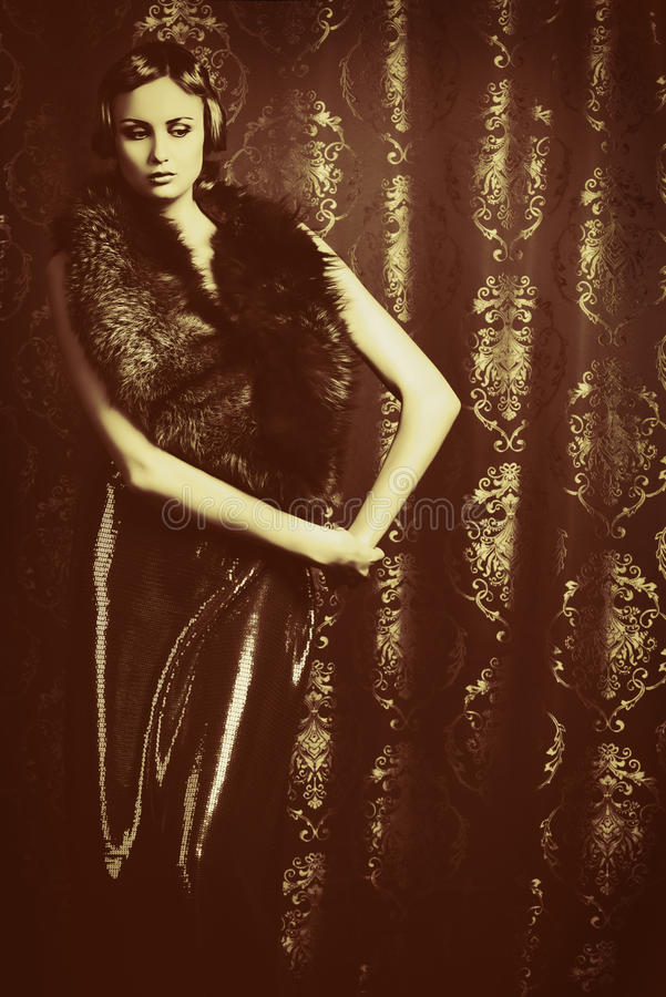 Vintage shot. Vintage portrait of a charming young woman royalty free stock photos