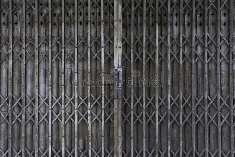 Vintage Shutter door, old rusted iron sliding gates, background stock photography