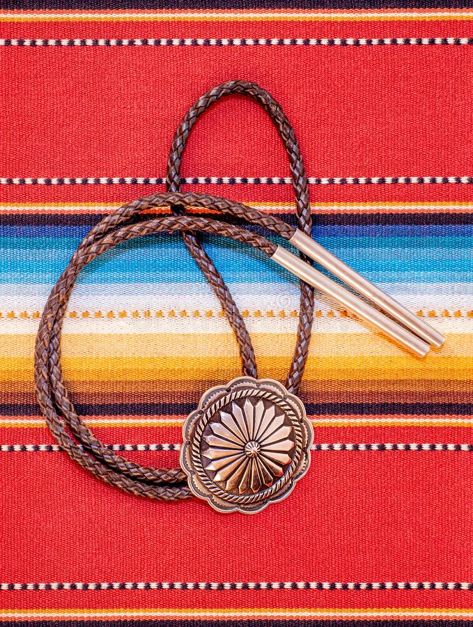 Vintage Silver Bolo Tie on colorful background. stock photos