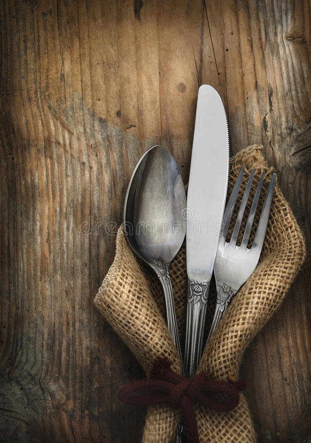 Vintage silverware. On rustick wooden background royalty free stock photo