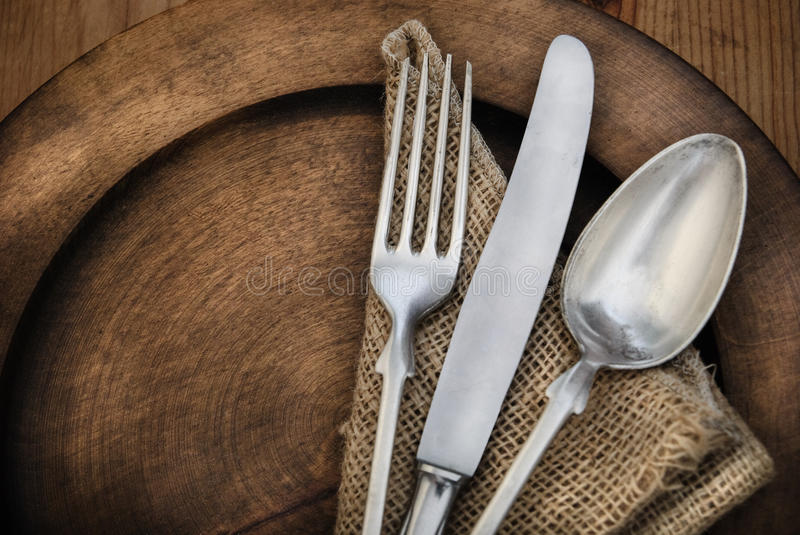 Vintage silverware. On rustick wooden plate stock photos