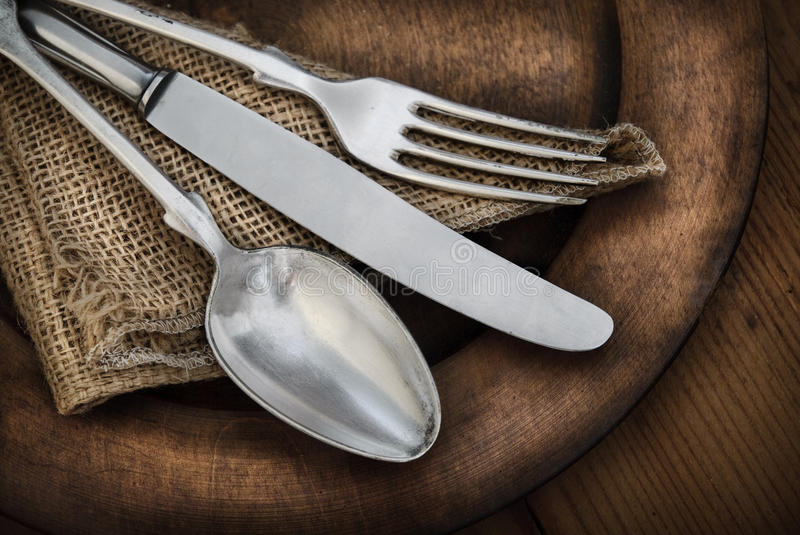 Vintage silverware. On rustic wooden plate royalty free stock photo