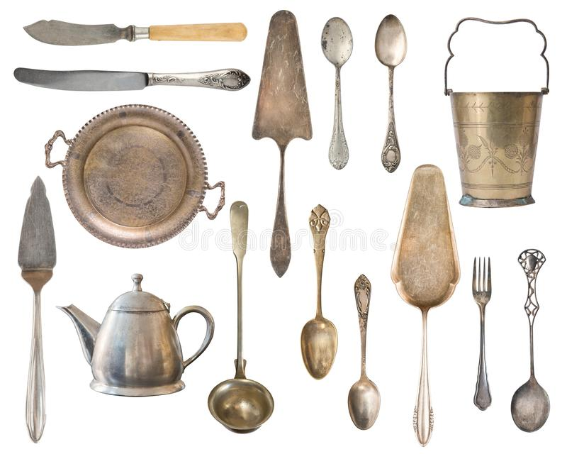 Vintage Silverware, antique spoons, forks, knives, ladle, cake shovels, kettle, tray and ice bucket isolated on isolated white. Background. Antique silverware stock image