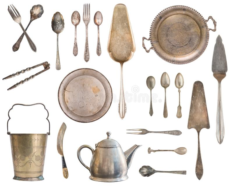 Vintage Silverware, antique spoons, forks, knives, ladle, cake shovels, kettle, tray and ice bucket isolated on isolated white. Background. Antique silverware royalty free stock images