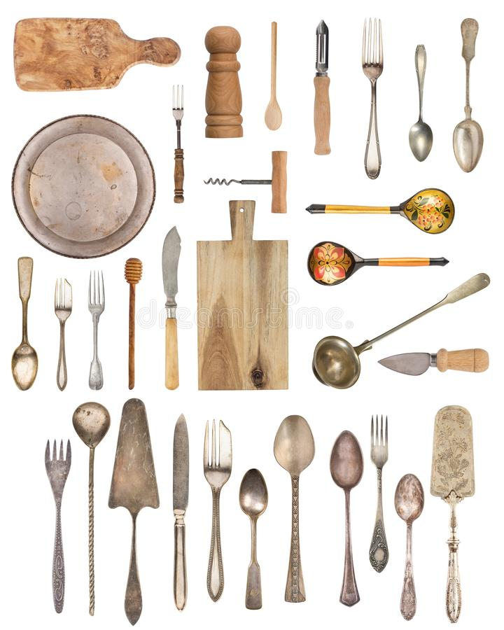 Vintage Silverware, antique spoons, forks, knives, ladle, cake shovels, kettle, tray and ice bucket isolated on isolated white. Background. Antique silverware royalty free stock photo
