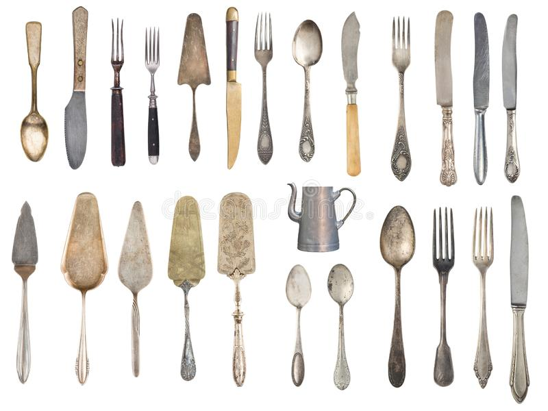 Vintage Silverware, antique spoons, forks, knives, ladle, cake shovels, kettle, tray and ice bucket isolated on isolated white. Background. Antique silverware stock photos