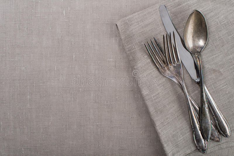 Vintage silverware for country garden party. Old forks, knife, spoon as background for country garden party stock photo