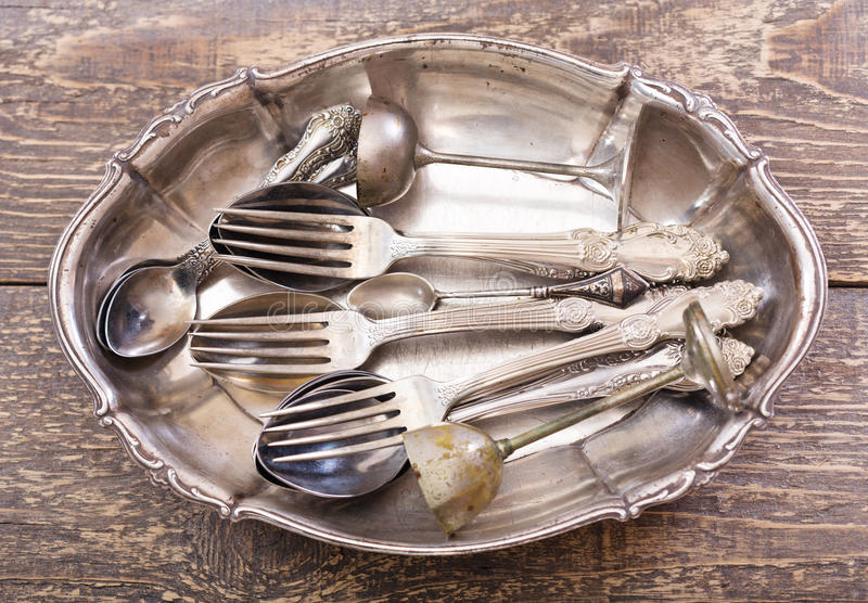 Vintage silverware. On wooden background royalty free stock image