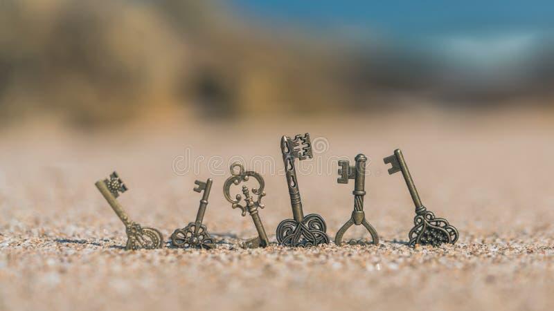 Vintage Keys On Sand Beach stock photo