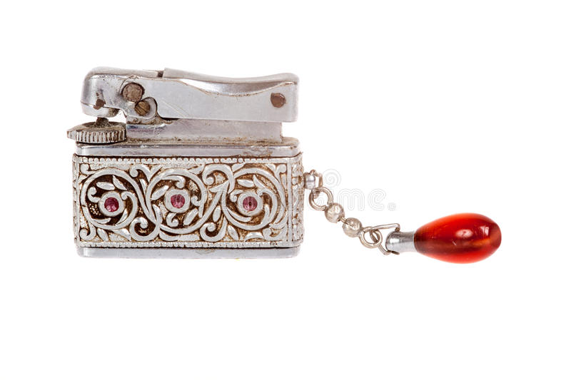 Vintage sliver lighter with red jewel. Isolated royalty free stock photos
