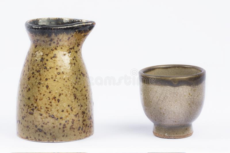 Vintage small Sake Pitcher and Cup on isolate white background. stock image