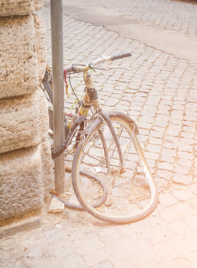 Vintage smashed bicycle on a street in Rome, Italy. Sidewalk royalty free stock photo