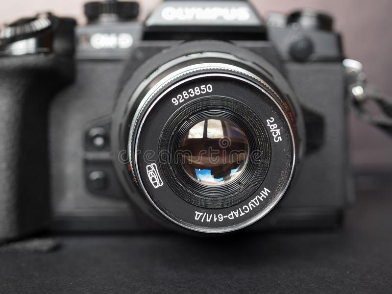 Vintage Sovietic lens. MOSCOW, RUSSIA - CIRCA SEPTEMBER 2018: Vintage Sovietic lens mounted on modern Olympus digital camera. The text in Russian means Industar stock image