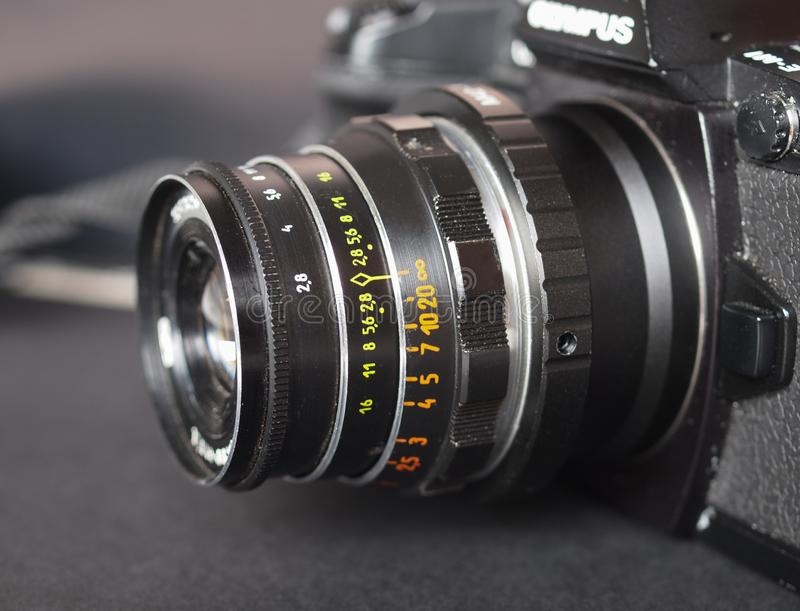 Vintage Sovietic lens. MOSCOW, RUSSIA - CIRCA SEPTEMBER 2018: Vintage Sovietic lens mounted on modern Olympus digital camera. The text in Russian means Industar royalty free stock photo