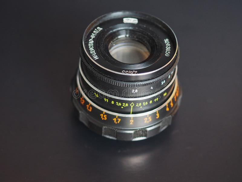 Vintage Sovietic lens. MOSCOW, RUSSIA - CIRCA SEPTEMBER 2018: Vintage Sovietic lens. The text in Russian means Industar 61 L-D stock photo