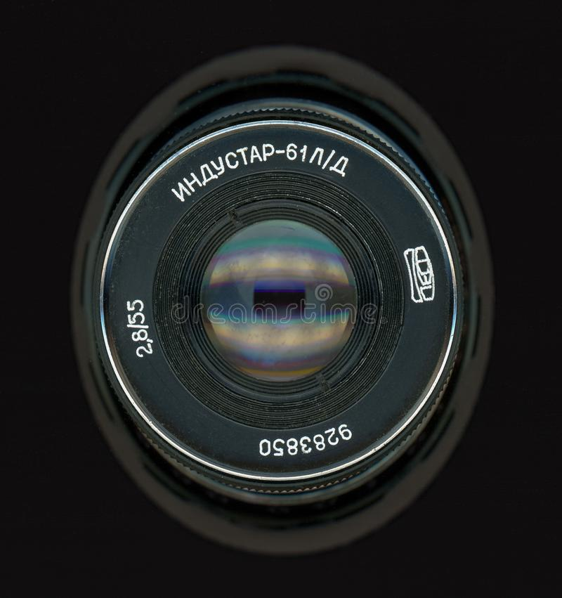 Vintage Sovietic lens. MOSCOW, RUSSIA - CIRCA SEPTEMBER 2018: Vintage Sovietic lens. The text in Russian means Industar 61 L-D stock photography