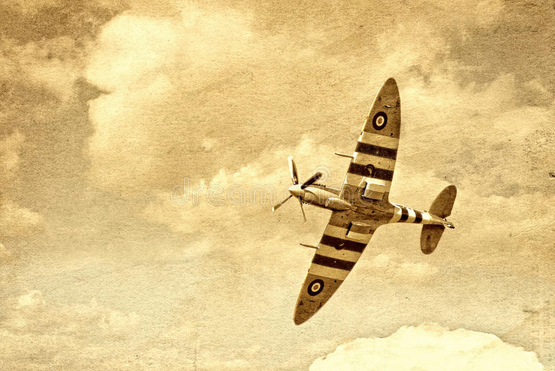Vintage Spitfire. An image of a vintage spitfire airplane, in a textured yellow background. Great for vintage aeroplane articles, fiction stories and fanfare stock photo