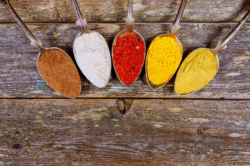 Vintage Spoons with Different Various colorful spices stock photography