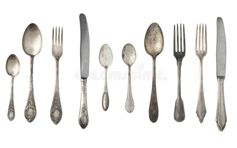 Vintage spoons, forks and knives isolated on a white background. royalty free stock photography
