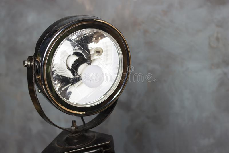 Searchlight on wooden legs. Vintage searchlight. Old floodlight royalty free stock photos