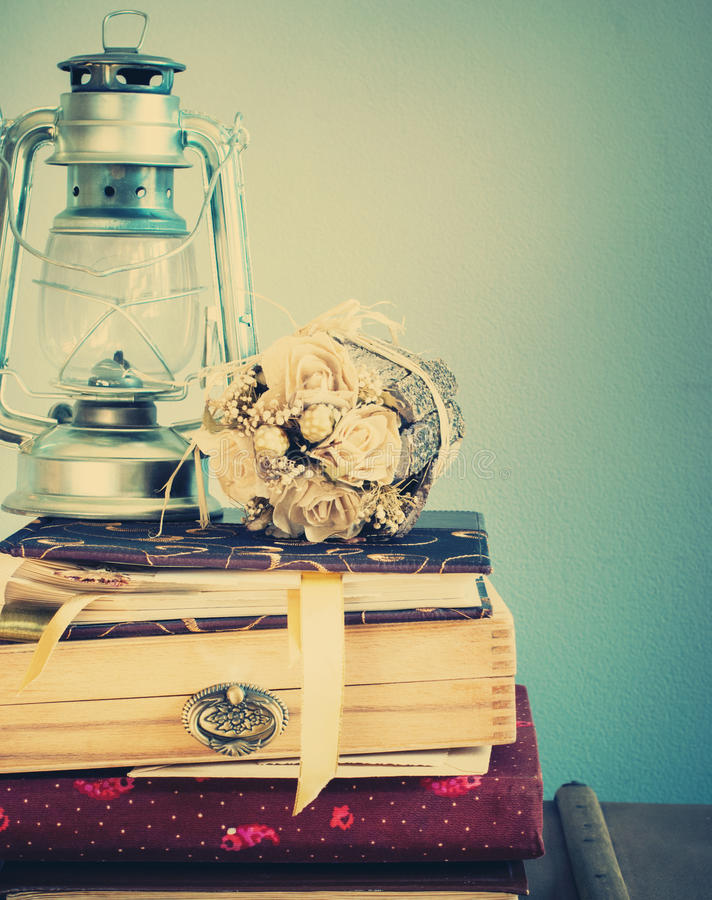 Vintage Staf in Retro Composition, pastel colors. Vintage Albums with Dry Bouquet and Oil Lamp in Vintage Composition, pastel colors stock photography