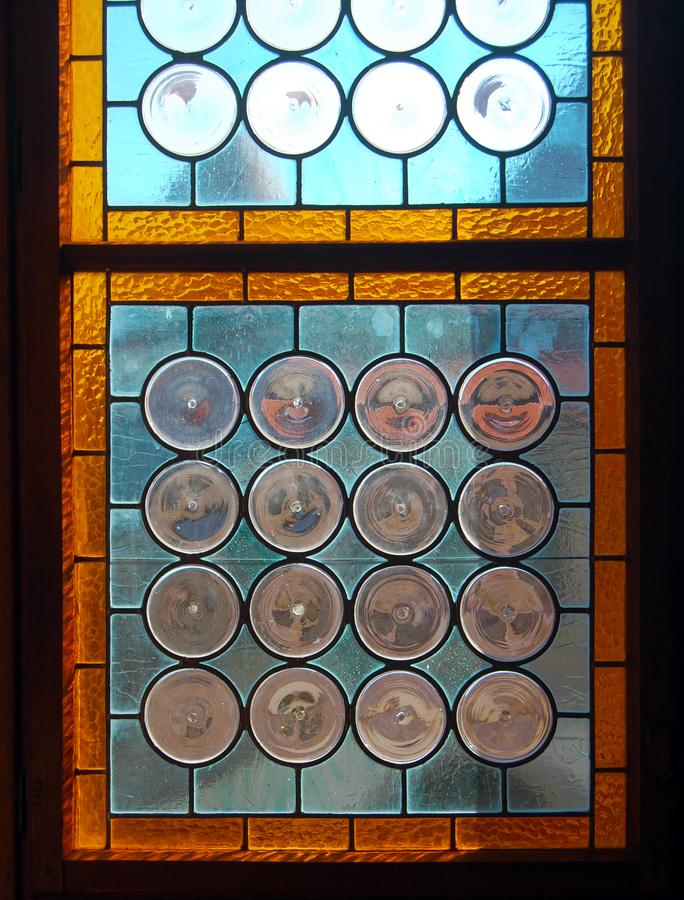 Vintage stained-glass window in old castle interior. Hunedoara, Romania royalty free stock photo