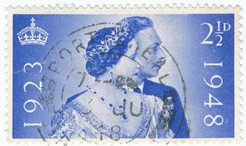 Vintage stamp printed in Great Britain 1948 shows the 25th Anniversary of the Wedding of King George and Queen Elizabeth royalty free stock image