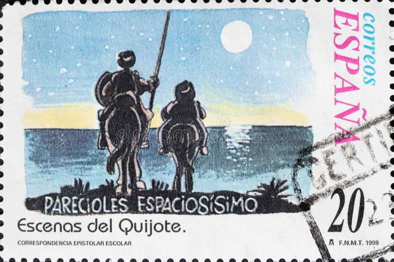 Vintage stamp shows Don Quixote and Sancho Panza stock images