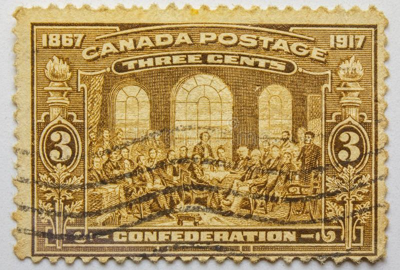 VINTAGE STAMP. CANADA three cents. 1917 Limited Series. VINTAGE STAMP. THREE CENTS, sepia print, fine grafics. Macro photo, stamp from CANADA of the past stock images