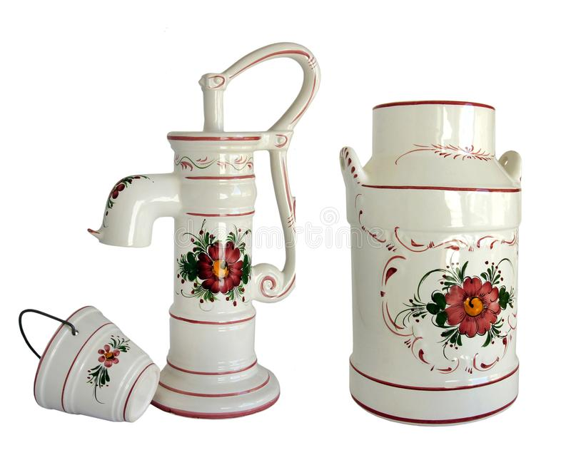 Vintage standpipe and bucket. Vintage porcelain street standpipe with bucket and water canister decorated with flowers isolated on white royalty free stock image