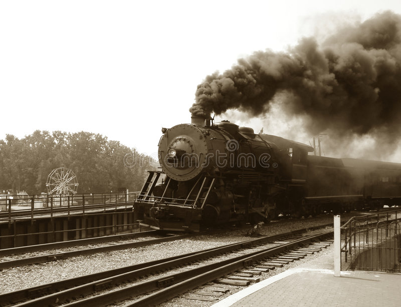 Vintage Steam Engine Locomotive and Train Speeding royalty free stock image