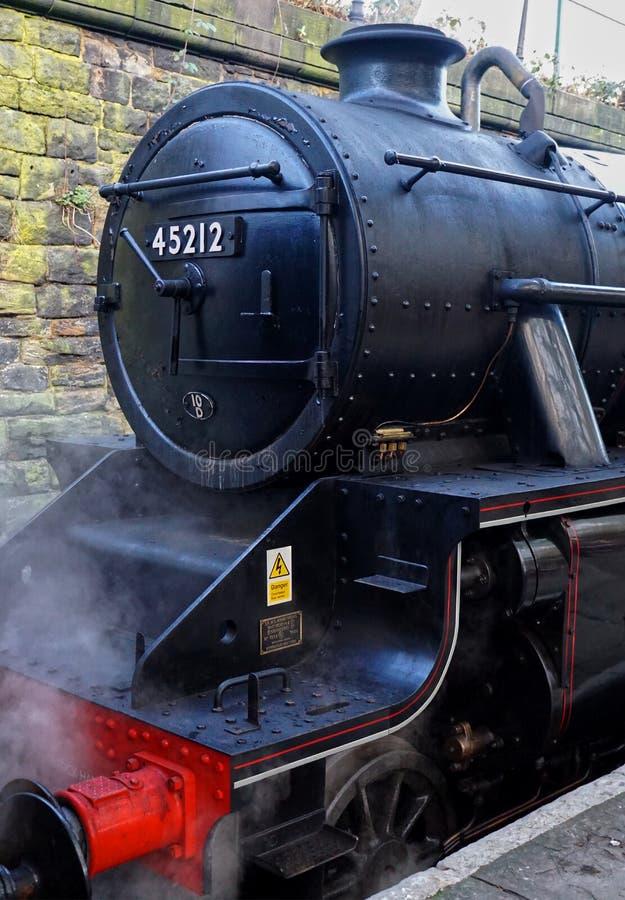Vintage Steam Locomotive at East Lancashire Railway Train Station. Bury, United Kingdom - March, 11, 2018. Vintage Steam Locomotive at East Lancashire Railway stock photo