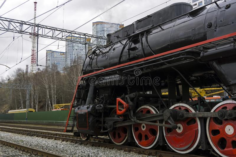Vintage steam locomotive on a modern railway royalty free stock images
