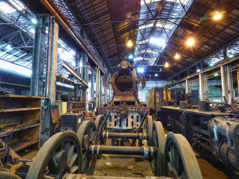 Vintage Steam locomotives under restoration royalty free stock photo
