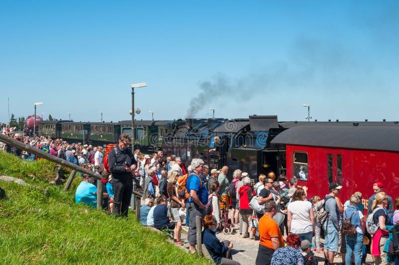 Vintage steam train arriving towards Brocken train station in Germany stock photo